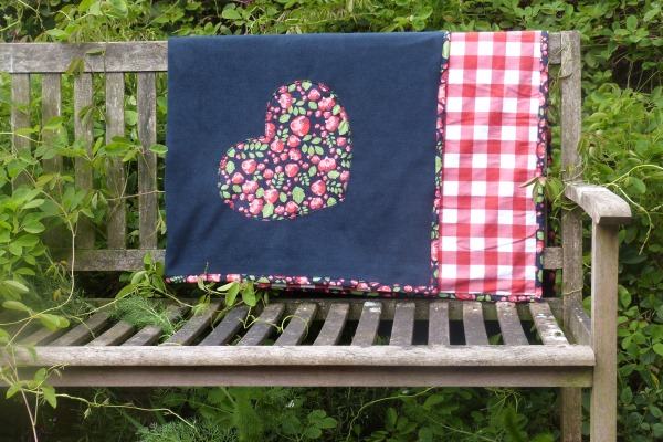 dog blanket and sofa throw in navy fleece with navy floral design