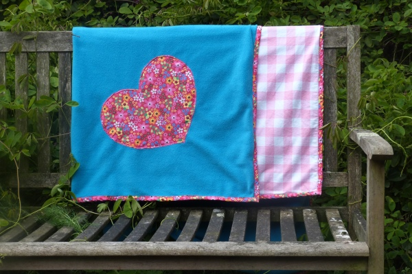 dog blanket and sofa throw in turquoise with cerise floral design