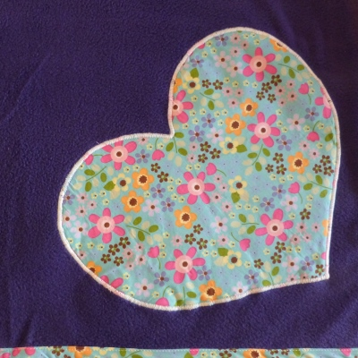 dog blanket in purple fleece with turquoise floral heart