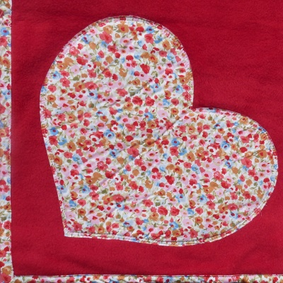 dog blanket in red fleece with coral floral detail