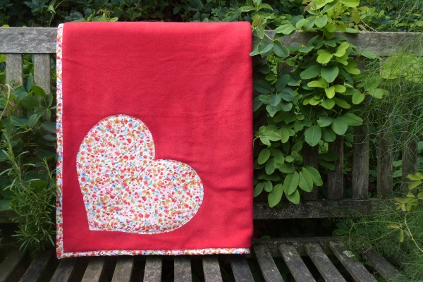 sofa throw in red fleece with coral floral